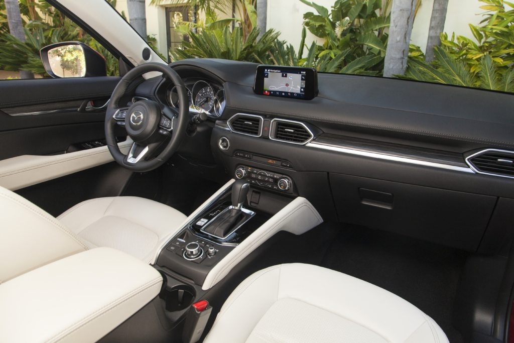 qa what is the difference between the cx 5 touring vs Mazda Touring Vs Grand Touring