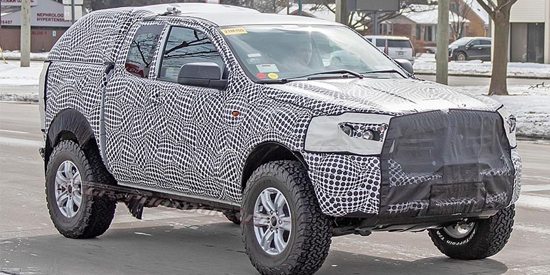 spy shots ford bronco testing with disguised pickup body Ford Bronco Spy Photos
